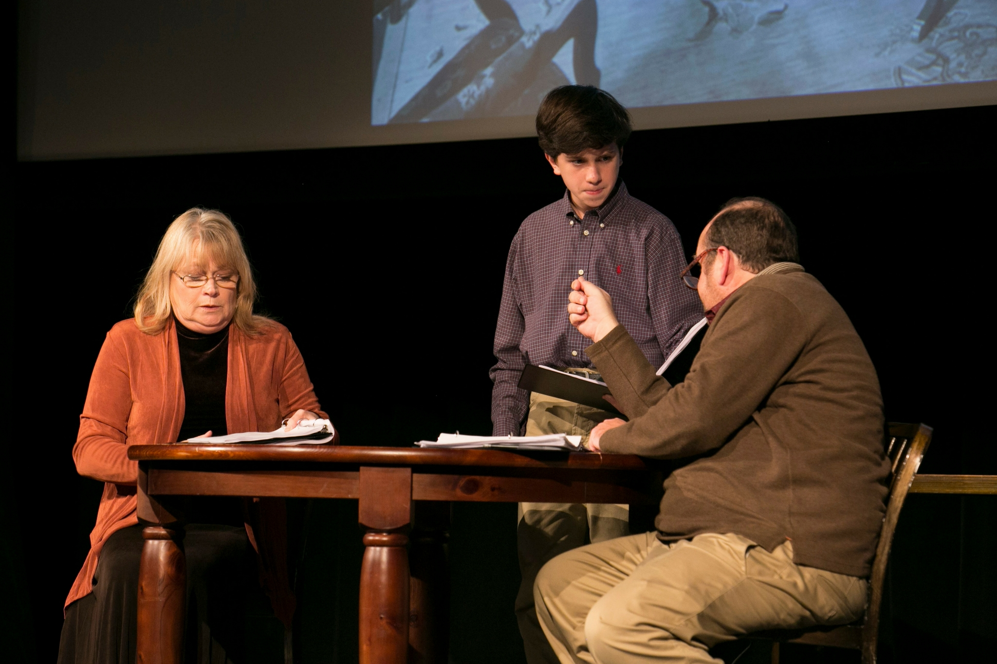 Karen MacDonald (Wife), Seamus Doyle (Boy), and Brandon Whitehead (Husband) in The Informer, Theatre in the Rough, 2017-Photo by Evgenia Eliseeva